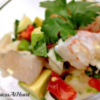 Close up of shrimp ceviche in a glass dish.