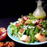 Salad with grilled peach half