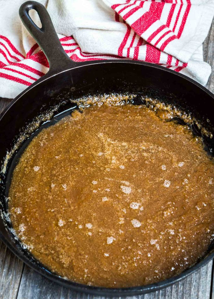Melted brown sugar and butter in the bottom of a cast iron skillet