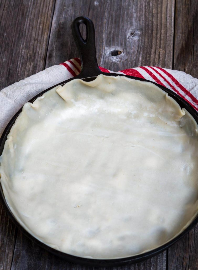 Cast Iron skillet lined with a rolled pie crust
