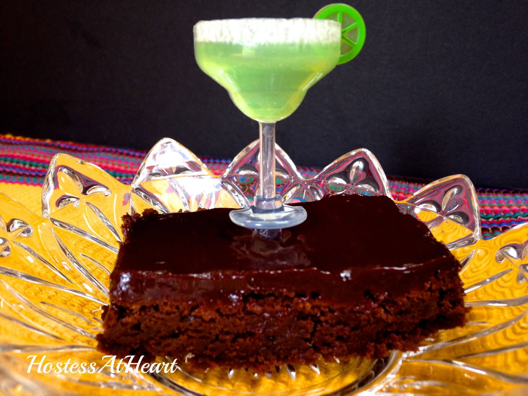 Mexican Brownies have a deep moist chocolate goodness with a back-end spicy hello! You are going to love watching your friends eat these when that surprise kicks in - HostessAtHeart.com