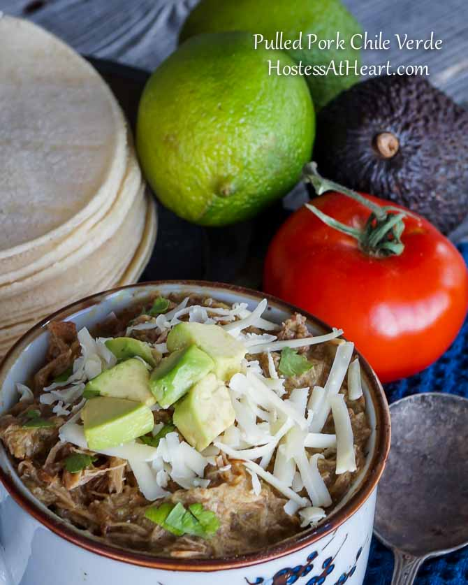 Pulled Pork Green Chile Verde can be enjoyed any time of year. It is a complete meal as is or can be made into a delicious stew, enchiladas, or tacos! | HostessAtHeart.com
