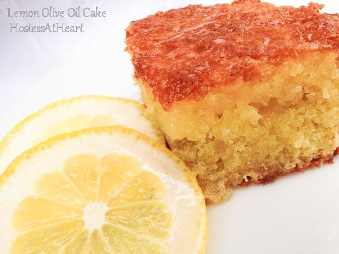 The color of this Lemon Olive Oil Cake is gorgeous, the smell is amazing, and best of all, it's easy to put together. It tastes like summer all year long. | HostessAtHeart.com