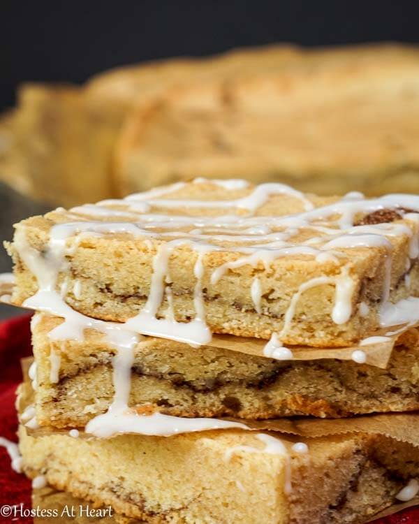 A quick and easy Snickerdoodle Bars that combines a sweet buttery sugar cookie with warm cinnamon and vanilla. - Hostess At Heart.com