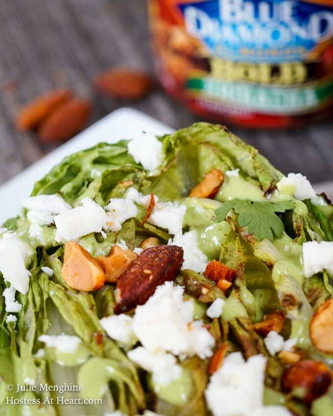 Southwestern Grilled Romaine Salad is topped with a delicious creamy avocado cilantro dressing, Queso Blanco cheese, and Blue Diamond Bold Sriracha almonds. These nuts add a great crunch to an already delicious salad. | HostessAtHeart.com
