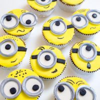 Top-down view of cupcakes decorated to look like minions.