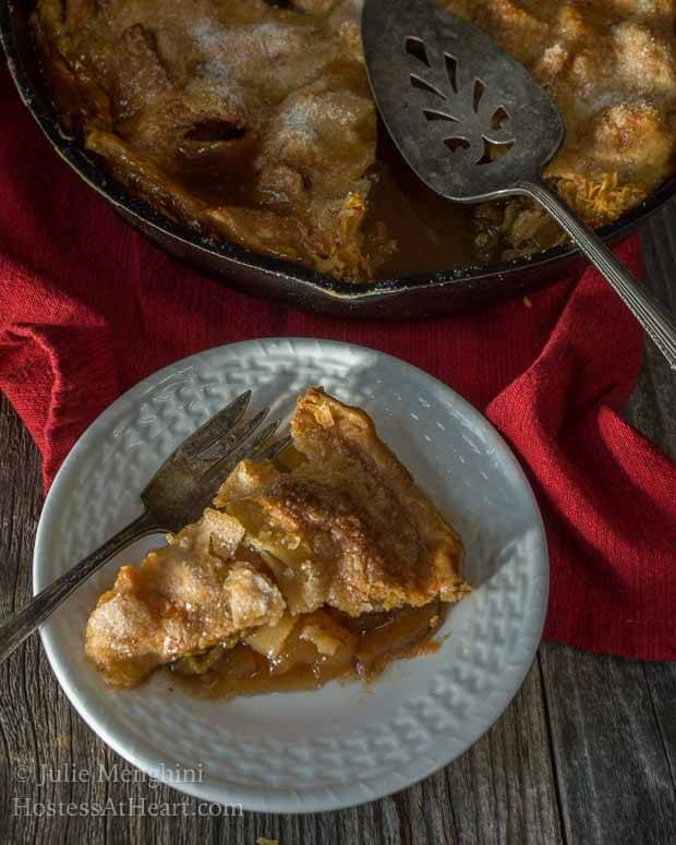 This Apple Rhubarb Skillet Pie recipe is a perfect blend of sweet and tart, all nestled in a warm buttery crust. It's easy to make and delicious to eat! | HostessAtHeart.com