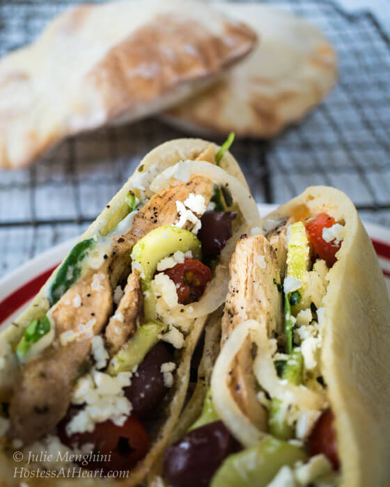 A quick and easy delicious Chicken Gyro recipe. You can either stuff the ingredients into a pita or make a healthy Greek salad. | Hostess At Heart-1