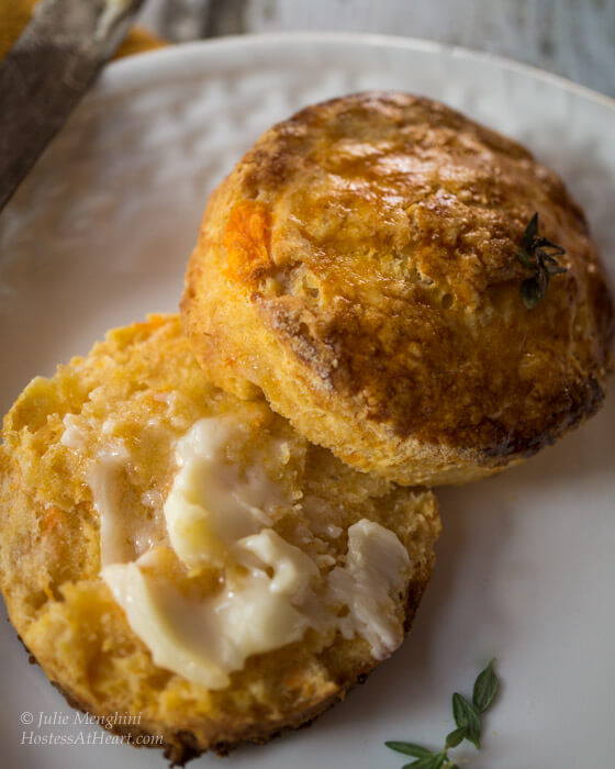 Herb-Topped Sweet Potato Biscuits are an easy delicious biscuit that combines the sweetness of the sweet potato with the savory herb. These biscuits are flaky and buttery with a nice little zing from cayenne pepper.   Hostess At Heart