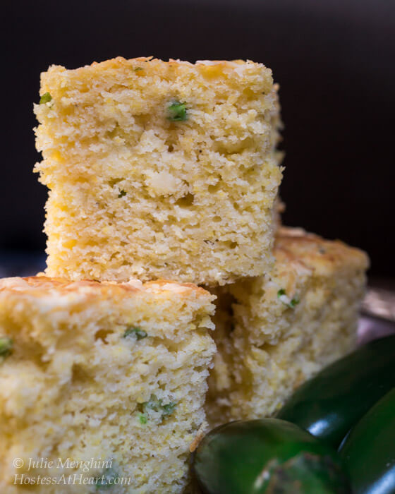 Sweet and Spicy Jalapeno Cheddar Cornbread is an easy to make recipe that goes perfectly with any meal that needs spiced up. It's delicious any time of year and makes enough to feed a good-sized crowd. | HostessAtHeart.com