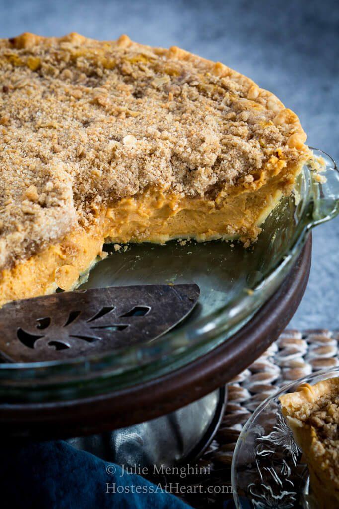 Cut view of a pumpkin cheesecake pie