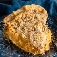 close-up top view of slice of pumpkin cheesecake pie