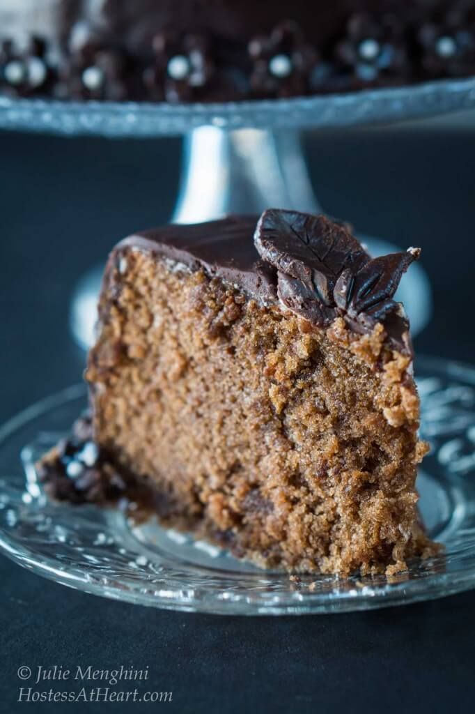 A slice of dark Chocolate Black Russian cake showing a creamy Kahlua filling and chocolate ganache.
