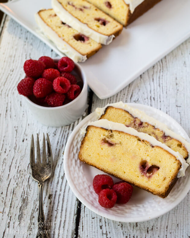 A light pound cake infused with raspberry and topped with a creamy cream cheese frosting. This Raspberry Swirl Pound cake will not last long on any table.