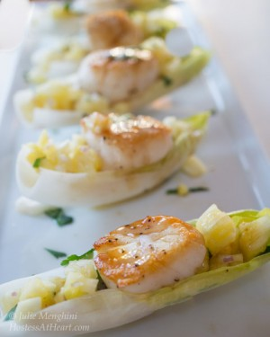 Row of Scallops on endive leaves
