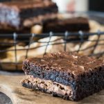 Thick and gooey dark chocolate brownies with a layer of chocolate toffee candy bar running through the center. Nothing is missing in this quick and easy dessert | HostessAtHeart.com