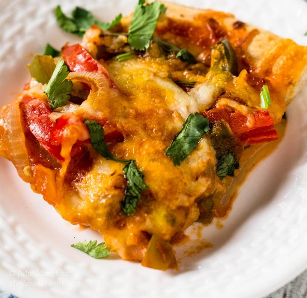 Fajita Pizza is a flavorful recipe that makes a quick and easy meal or appetizer. This is a vegetarian recipe and can be changed to you tastes | HostessAtHeart.com