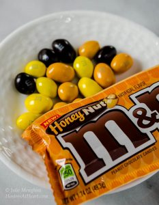 M&M's® Honey Nut Cookies taste like a big ole hug. They are warm from the fresh honey and the delicious flavor of the M&M's® Honey Nut candy gives these cookies a sweet nutty flavor | HostessAtHeart.com