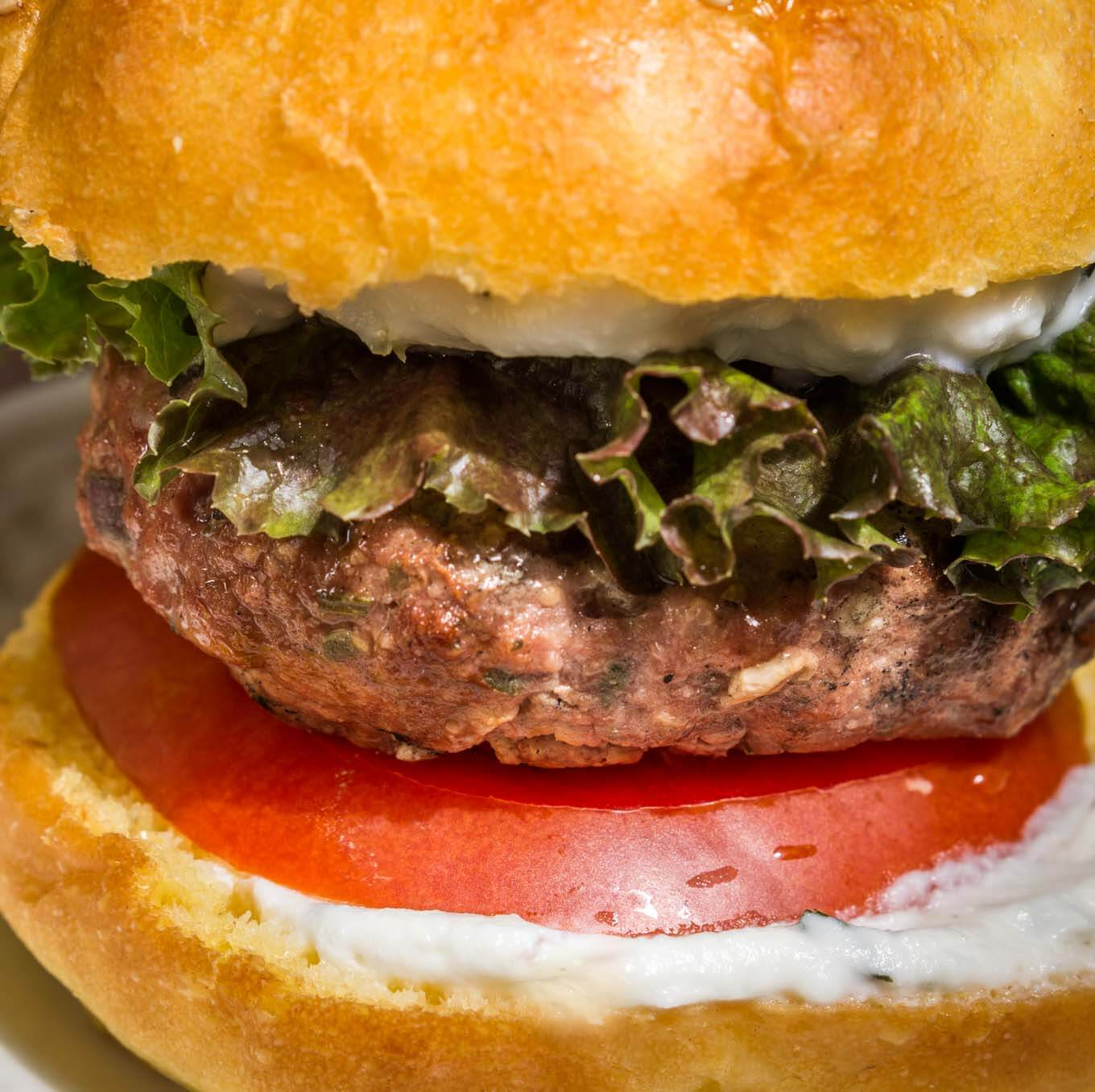 Greek Lamb Burger with Lemon Herb Sauce is one of the best burgers that you can make.  It's so flavorful it doesn't have to rely on salt for taste | HostessAtHeart.com