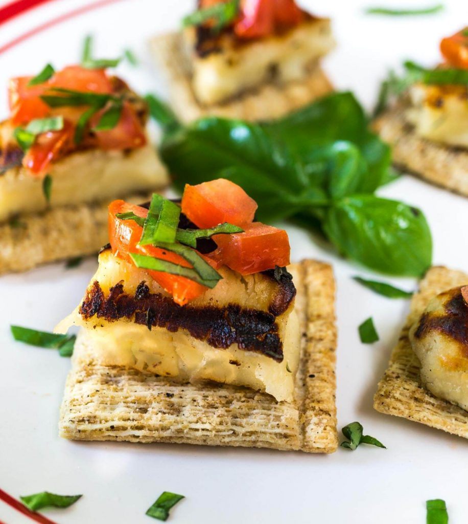 Grilled Halloumi with Tomato-Basil Topping on TRISCUIT Cracked Pepper & Olive Crackers makes one delicious appetizer, or in my case, LUNCH! | HostessAtHeart.com