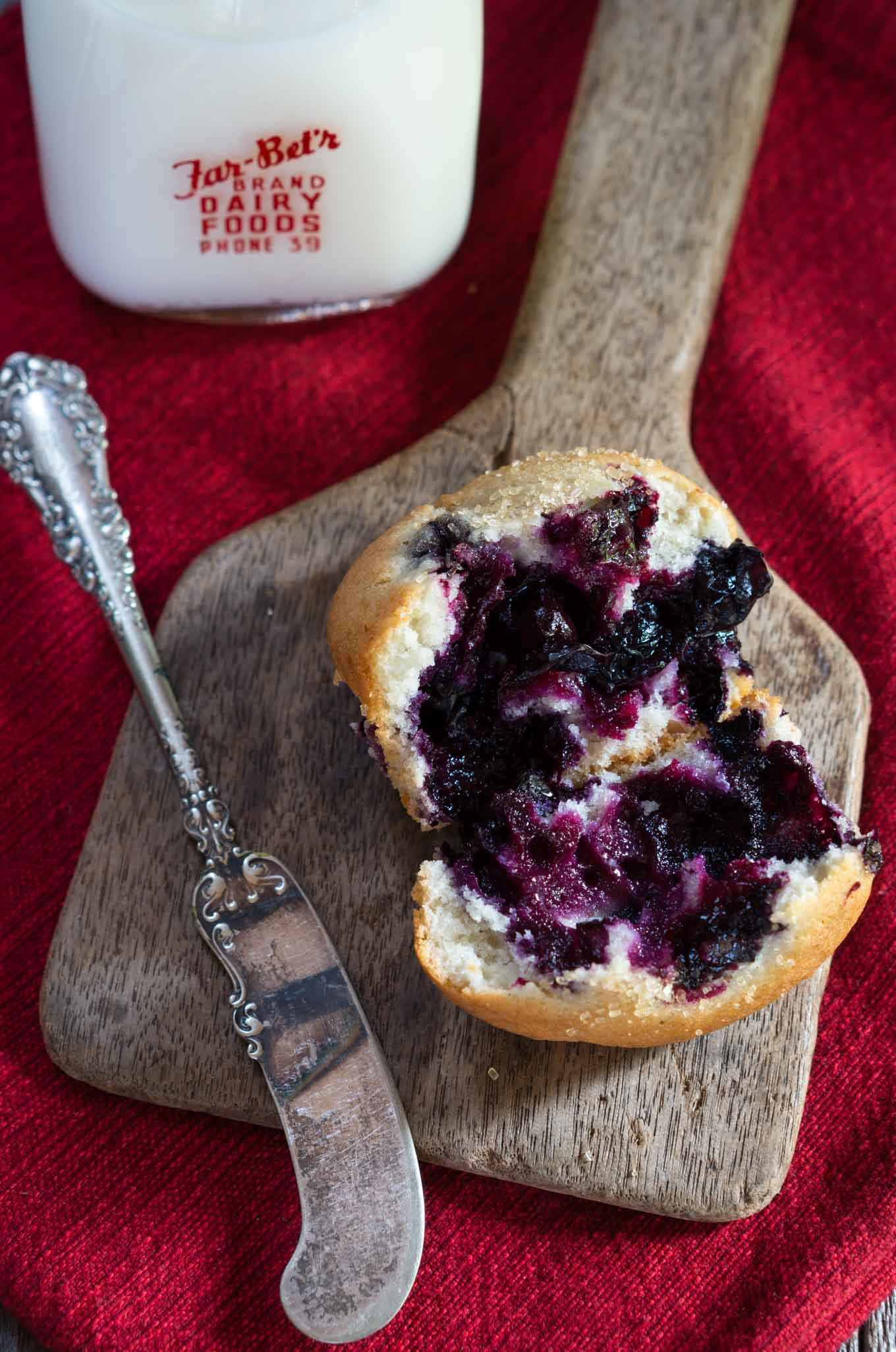 This Loaded Blueberry Muffin recipe says it all. It isn't overly sweet and is definitely all about the berries. It's perfect for breakfast, snack or with any meal when you'd like a slightly sweet addition | HostessAtHeart.com