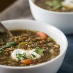 This Lentil Sausage Soup recipe is a delicious high protein soup that takes less than an hour to make but tastes like it took all day.   HostessAtHeart.com