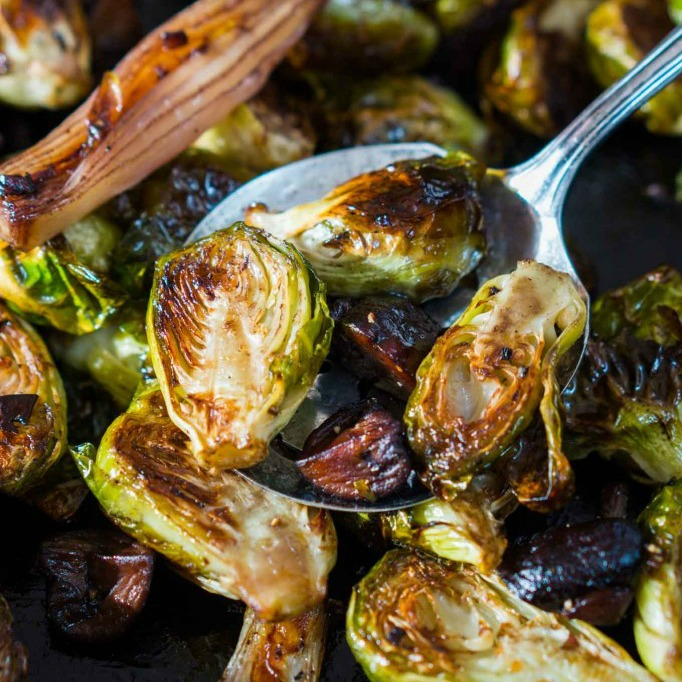 Roasted Brussels Sprouts and Shallots with Mushrooms dished on a serving spoon