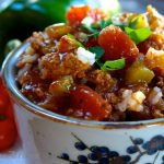 Stuffed Pepper Soup is a healthy and hearty dish that is a great way to use fall veggies. It's the perfect comfort dish to enjoy at the end of a long day.   HostessAtHeart