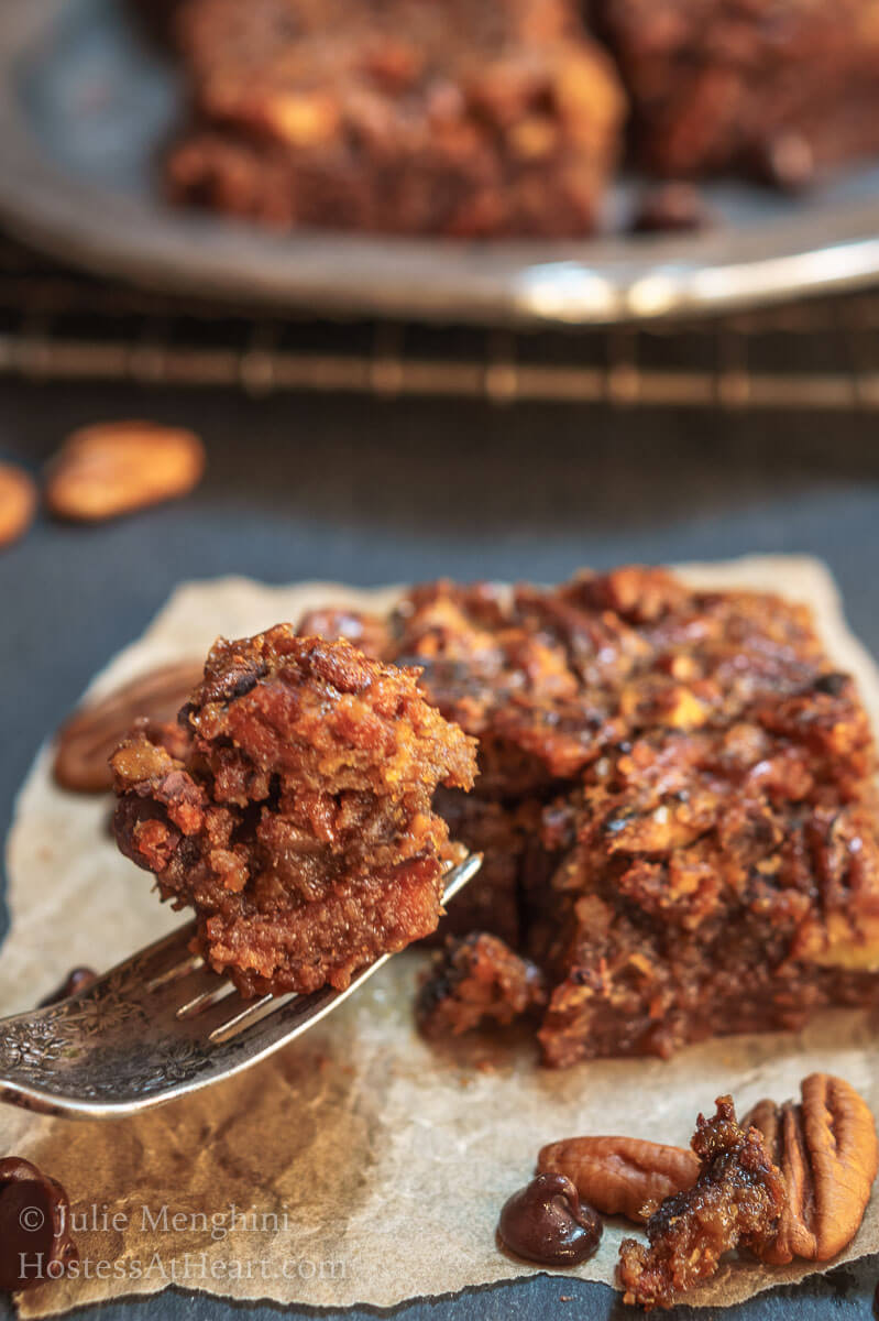 Derby Pie Brownie recipe is the best combination of a dark chocolate brownie and a pecan pie. It's rich, delicious, and perfect for any occasion. | HostessAtHeart.com
