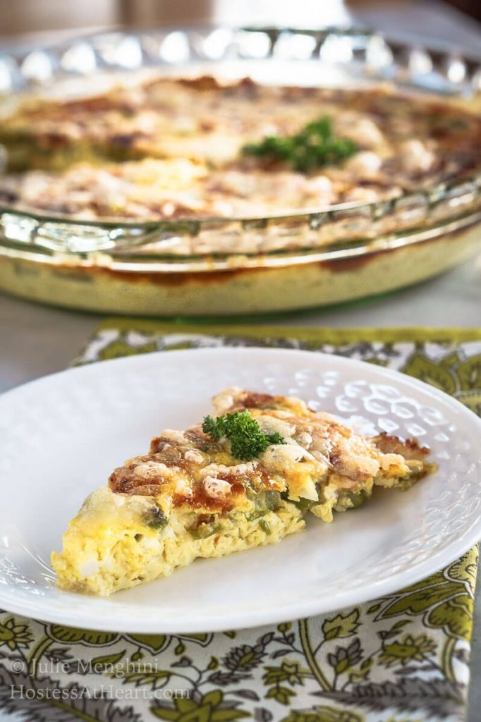 Crustless 3 Cheese Asparagus Quiche is an easy dish to put together and is perfect for company or any meal of the day. It's a snap to put together and easy to customize to your tastes. | HostessAtHeart.com