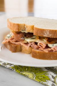 Ham, Melted Brie, Crispy Prosciutto Sandwich with Basil Aioli is a blend of textures and flavors that will tantalize the taste buds. | HostessAtHeart.com