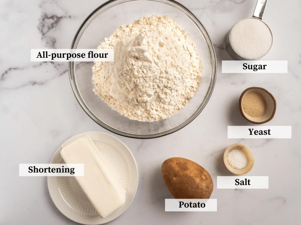 Ingredients used to make potato rolls including flour, shortening, salt, potato, sugar, and yeast