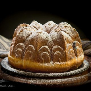 Table view of a Cherry Almond Kugelhopf dusted with powdered sugar.