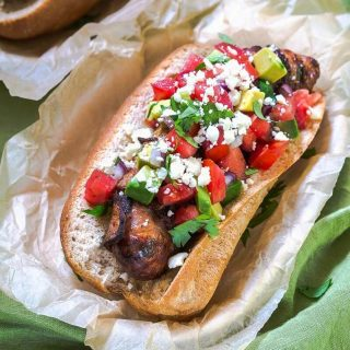 Take back dinner time!  Chipotle Garlic Bacon Wrapped Brats with Avocado Pico are quick, easy and best of all delicious!