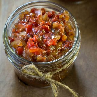 This Easy Fresh Balsamic Tomato Chutney recipe tastes like Summer in a bowl.  It's perfect as an appetizer or as a sauce over grilled seafood or chicken | HostesAtHeart.com