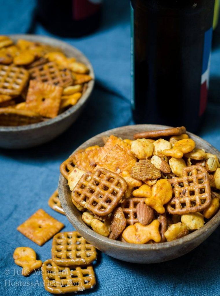 Spicy Sriracha Snack Chex Mix is one of those recipes that's a snap to make and quick to disappear.  It's perfect for when a whole lot of munching is going on.  | HostessAtHeart.com