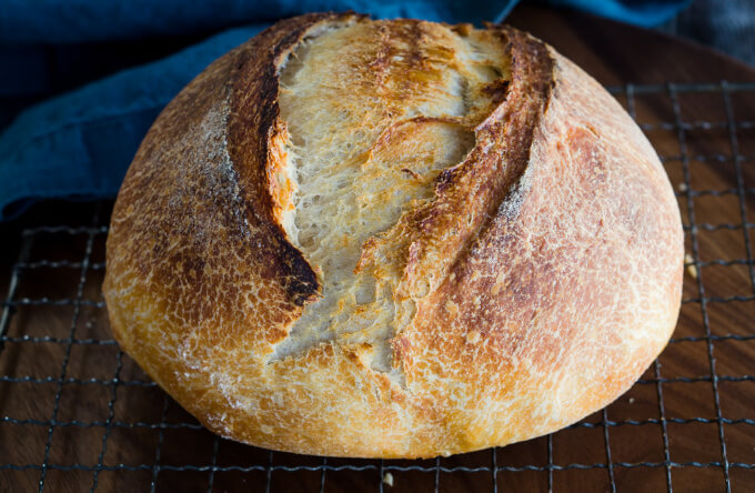 This beautiful sourdough loaf has a crust rustic experior and an soft and tender interior with a slight sour taste
