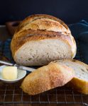 This is a beautifully slice sourdough loaf that shows the tender crumb and crusty exterior.