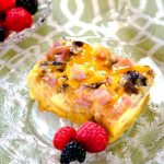 This Ham and Cheese Mushroom Strata Recipe is easy and can be made ahead which makes it perfect for entertaining and the holidays! | HostessAtHeart.com