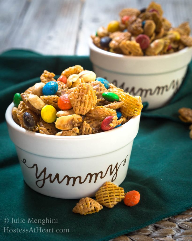 This Addictive Caramel Crispix Snack Mix is so good that people will ask you not to make it.  One batch will keep you and a ton of your friends munching all day long! | HostessAtHeart.com