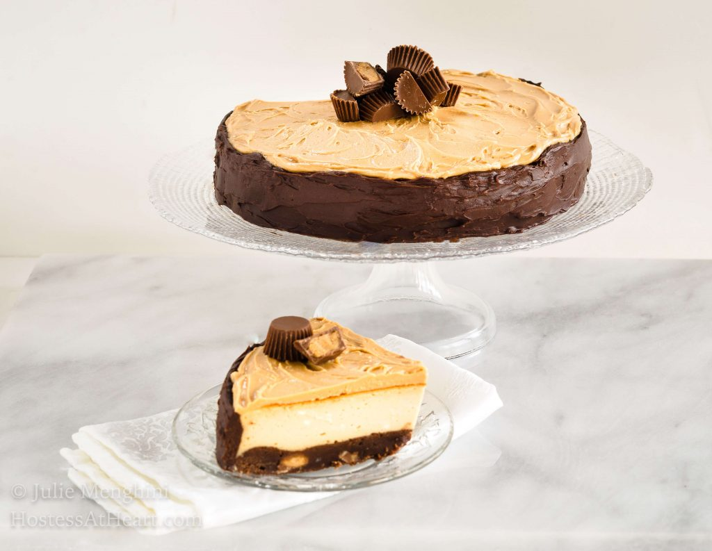 Buckeye Brownie Cheesecake is decadent and delicious.  The looks that you get when you cut into this rich and creamy cheesecake will have you making it over and over. | HostessAtHeart.com