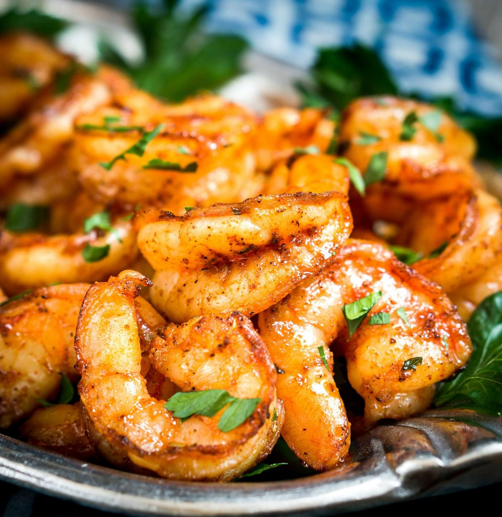 These Baked Blackened Shrimp are spicy red delicious, plump and mouthwatering. They make a great appetizer or topped on a salad, taco or pasta!