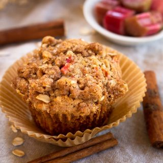 top view of a Rhubarb Oat Muffin with raw pieces of rhubarb in a bowl