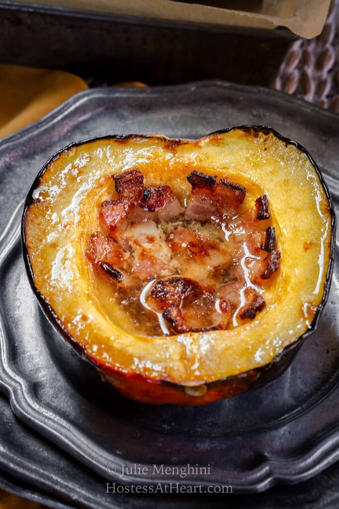 Top view of a half baked acorn squash filled with bacon