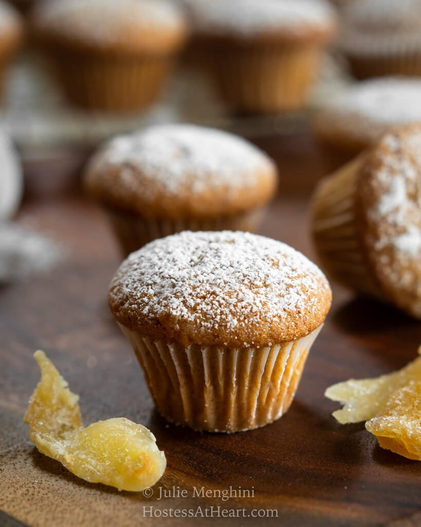 Central head on view of a mini ginger spice muffin with more muffins behind