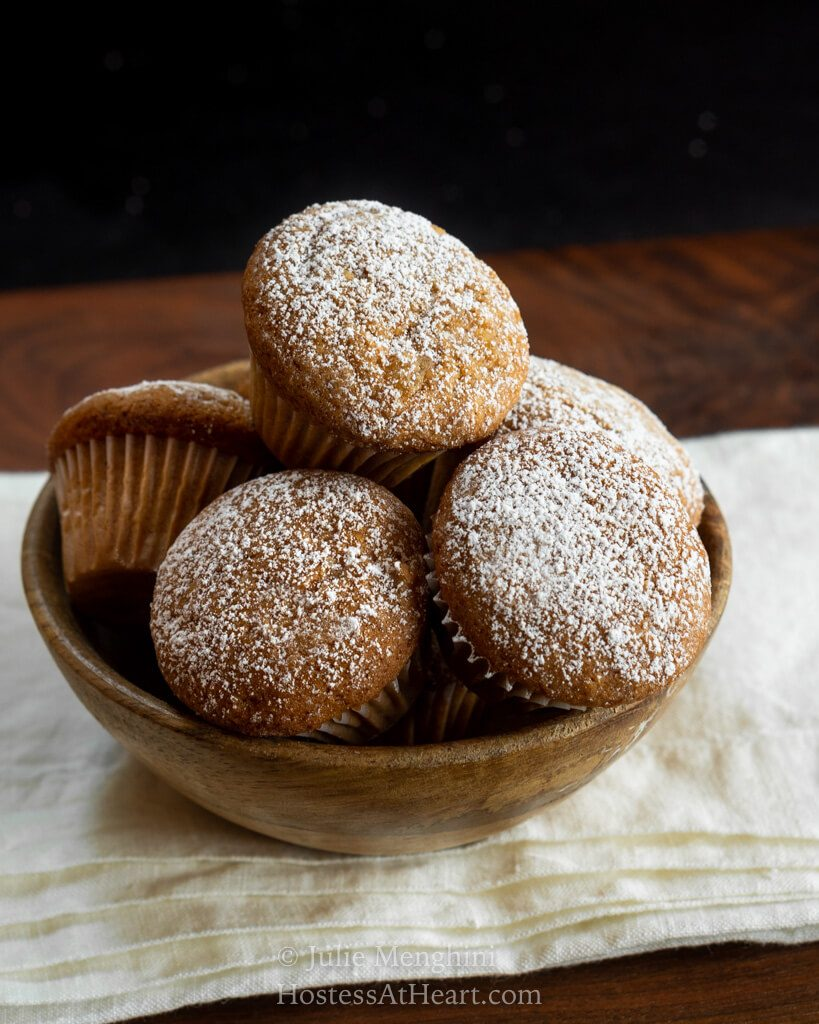 Wooden bowl filled with muffins
