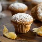 close up of a ginger spice muffin with slices of ginger next to it
