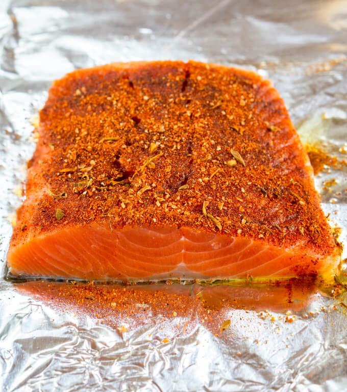 This piece of red dense salmon is loaded with blackened seasoning and is ready to be baked into a tender juicy meal