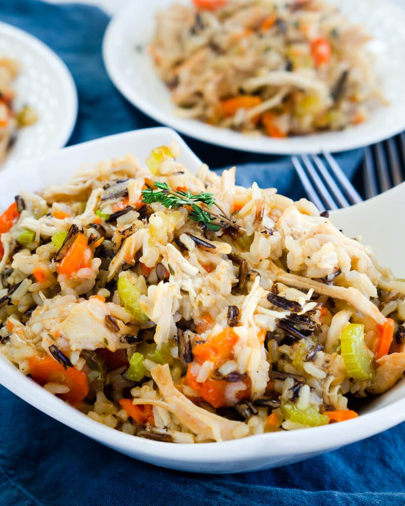 A full bowl of cream Instant Pot chicken and rice full of juicy chicken and veggies. It's a great healthy 30-minute meal.