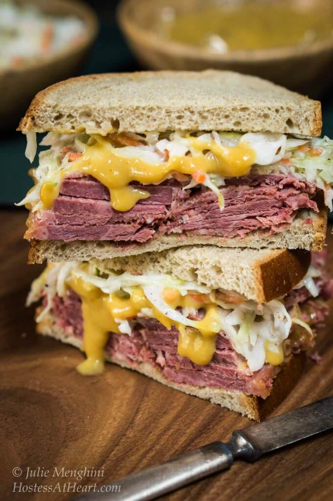 Corned Beef Cabbage Slaw Sandwich is slathered in a smooth mustard sauce and heaped with a caraway slaw.